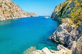 picture of greek-island  - View on sea bay on Greek Island with yacht achored, Greece ** Note: Soft Focus at 100%, best at smaller sizes - JPG