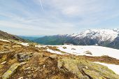 picture of italian alps  - Snowcapped mountain range and green valley in spring season - JPG
