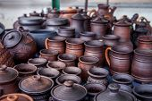 foto of pottery  - Pottery for sale at outdoor market. Travel