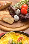 picture of quail egg  - bread tomatoes lettuce and quail eggs on a wooden cutting board - JPG