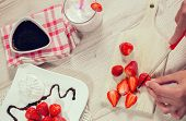 picture of chocolate spoon  - Fresh strawberries and whipped cream on a plate - JPG