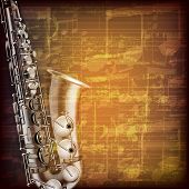 picture of saxophones  - abstract grunge brown cracked music symbols vintage background with saxophone - JPG