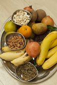 picture of dry fruit  - Top View of Fruits and dry fruits from thread ceremony function - JPG
