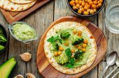 foto of chickpea  - vegan tortilla with roasted broccoli and chickpeas and avocado sauce - JPG