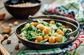 foto of chickpea  - chickpeas and spinach curry on a dark wood background - JPG