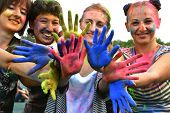 picture of holi  - girls with colourful hands after Holi festival - JPG