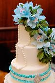 pic of three tier  - Detail of wedding cake on table with blue flowers