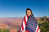picture of bundle  - Cheerful small boy who is bundled up into American flag with Grand Canyon National Park view - JPG