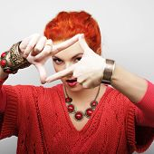 stock photo of lolita  - redhair woman making frame with hands - JPG