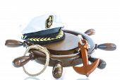 foto of anchor  - Decorative wooden ship anchored at the helm on a white background - JPG