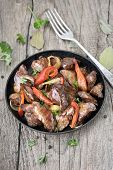 foto of liver fry  - Roasted chicken liver with pepper in frying pan on wooden table - JPG