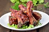 picture of ribs  - Baked pork ribs on wooden table close up view - JPG