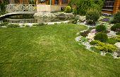 foto of ponds  - Arbor in garden with flowerbed - JPG