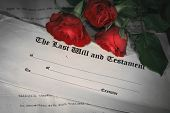stock photo of condolence  - Last will and testament with red roses - JPG