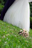 Bridal Bouquet Lies On The Grass
