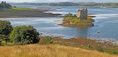 stock photo of bute  - Castle Stalker is on an island on Loch linnhe which is a sea loch in Argyll and Bute Scotland - JPG