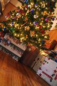 Decorated Christmas Tree Surrounded By Gifts