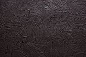 image of leather tool  - dark brown leather texture embossed pattern for background - JPG