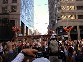 Giants Fans Celebrate And Take Photos Of The Passing Of Trolleys Featuring Giants Players