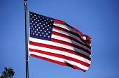 foto of ronald reagan  - the flag of the USA flying in the wind in front of the Ronald Reagan Library - JPG