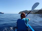 Redheaded Lady Paddles Kayak Toward Catalina Island