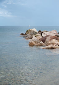picture of cape-cod  - ocean rocks in the water with the white yacht on the horizon - JPG