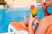 Woman Hand Drinking Cocktail Near Swimming Pool