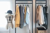 Modern Style Wardrobe With Clothes poster