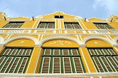 Facade of a colonial house in Willemstad, the capital of Curacao, in the Caribbean. Downtown Willems