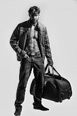 Muscular Bearded Man With Sexy Body Holds Big Bag, Suitcase poster