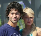MALIBU, CA - AUG 19: Adrian Grenier takes a break from filming his documentary with Paris Hilton and