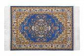 Rectangular turkish carpet horizontally lies on  white background