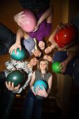 Girls and youths stand in close circle and everybody gets on  hip  ball for bowling