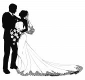 picture of wedding couple  - A bride and groom on their wedding day about to kiss in silhouette - JPG