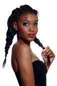portrait of beautiful South African young woman with long hair in braids and bright artistic makeup over white background
