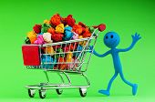 Recylcing concept with color paper and shopping cart