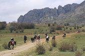 Horsemen Going To Mountains