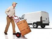 delivery man with handtruck and truck background