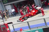 Fernando Alonso exits his pit garage