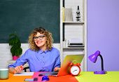 Student Studying In Classroom. Funny Female Teacher In Classroom. Student In College. World Teachers poster