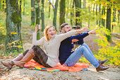 Expedition Concept. Couple In Love Relax In Autumn Forest With Tea Or Coffee. Family Picnic. Camping poster