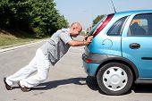 Man Pushing A Car