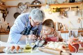 Family Is Cooking In Cozy Kitchen At Home. Grandmother And Child Are Making Italian Food And Meal. S poster