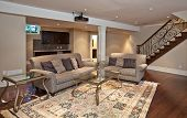 pic of guest-house  - Modern home entertainment room in the basement - JPG