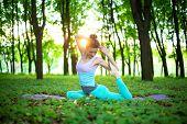 Thin Brunette Girl Doing Mermaid Exercise, Eka Pada Rajakapotasana Pose In A Summer Park On A Sunset poster