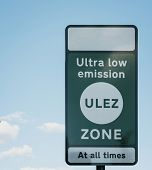 Sign Indicating Ultra Low Emission Zone (ulez) In London Against Blue Sky And Clouds. Ulez Was Intro poster