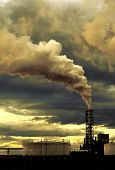 stock photo of noise pollution  - Polluting thick smoke coming out of factory chimney