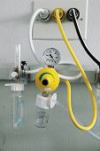 picture of vacuum pump  - yellow  Oxygen inhalation equipment on hospital bed - JPG