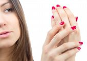 Beautiful Female Hands Red Manicure Shellac  Near Face