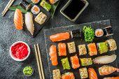 Assorted Sushi Set On Stone Or Concrete Background.  Japanese Classic Sushi, Sushi Nigiri. Rolls, So poster